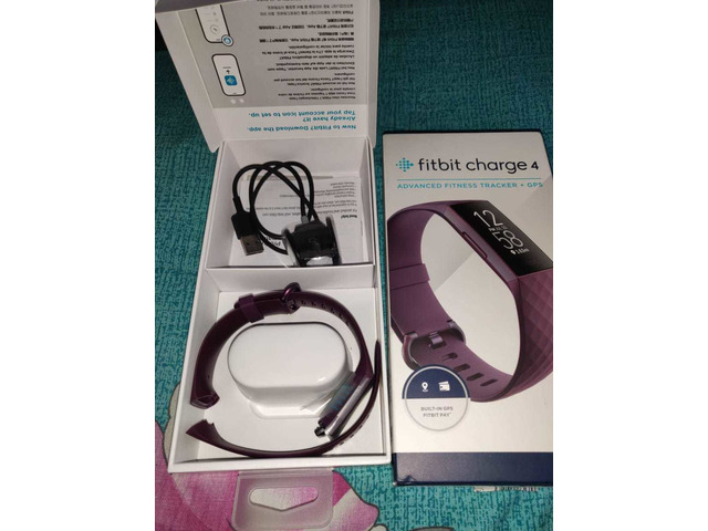 Headphone and Fitbit charger - 1/6