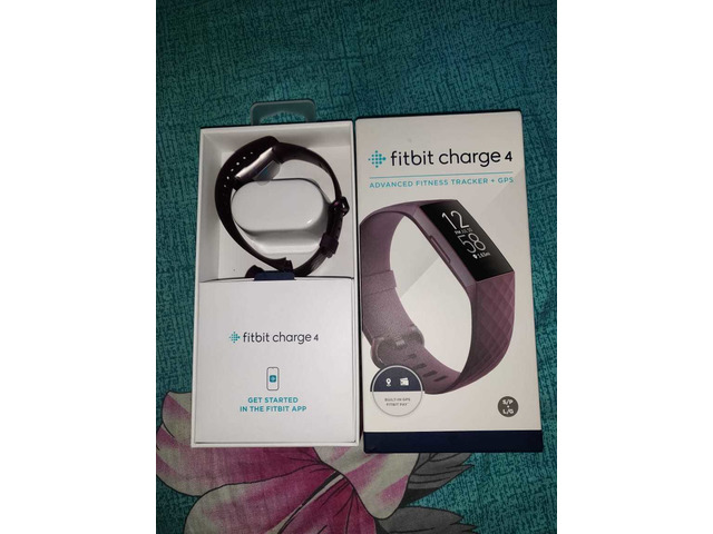 Headphone and Fitbit charger - 2/6
