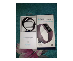 Headphone and Fitbit charger - Image 2/6