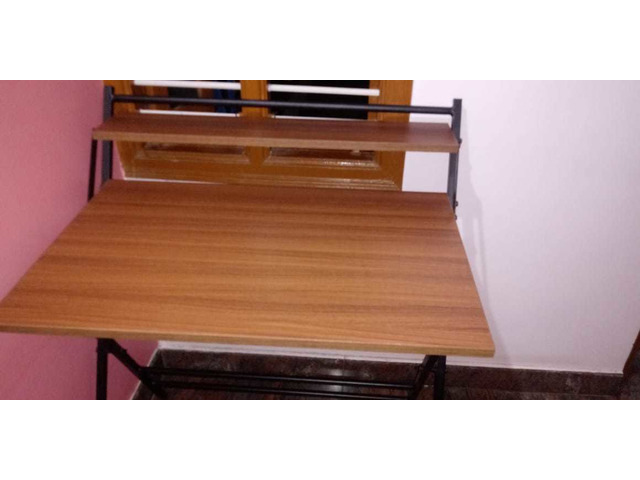 Study Table foldable brand new with full pacakage nilkamal brand walnut colour in good condition. A. - 8/10